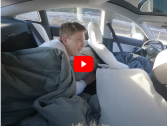 A driver sleeps in the back seat of a Tesla while its driving itself!